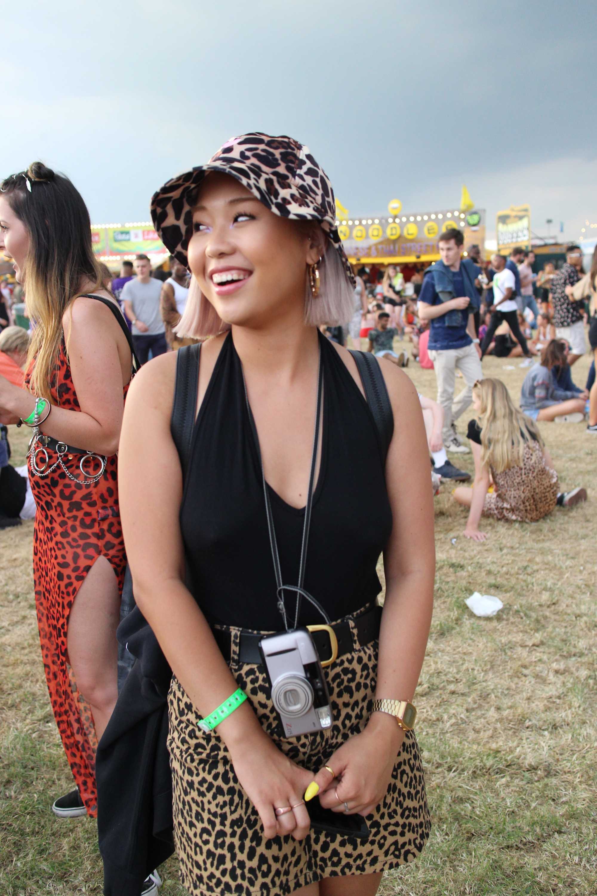 Festival hair accessories: Woman at Lovebox 2018 with a sharp bob length hair worn with a bucket hat