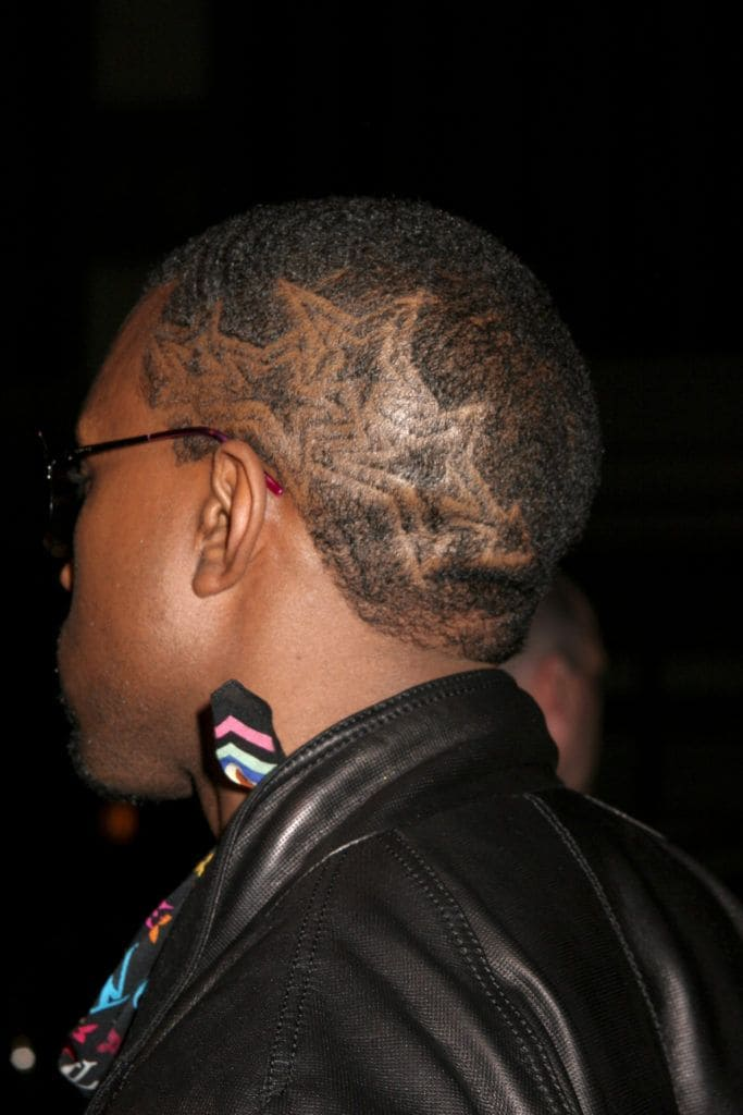 Kanye West in 2006 with shaven star pattern on the side of his head