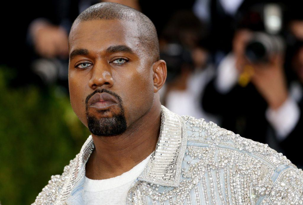 Kanye West in 2016 at the Met Gala with close shaven head