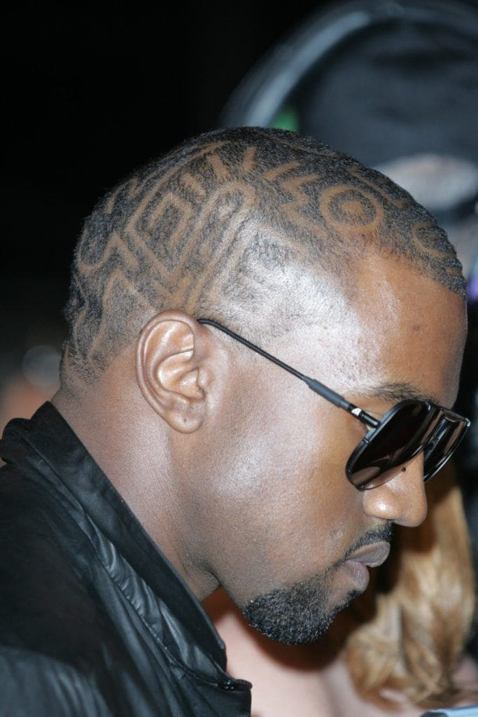 Kanye West in 2009 at the VMA Awards with Aztec print shaved head