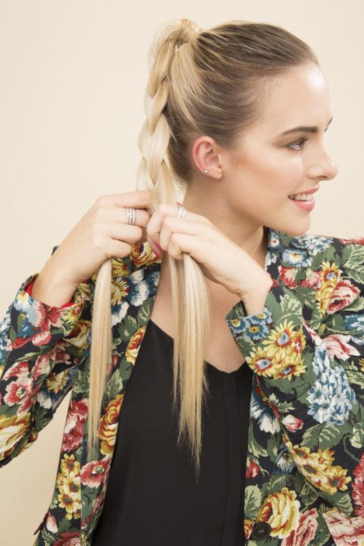 blonde model braiding a high ponytail