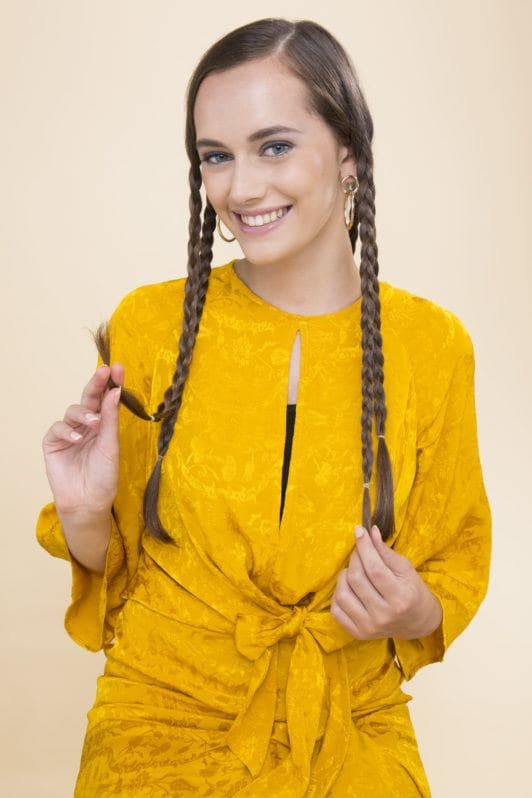 Overnight curls tutorial: medium brown hair model with long straight hair plaiting her hair