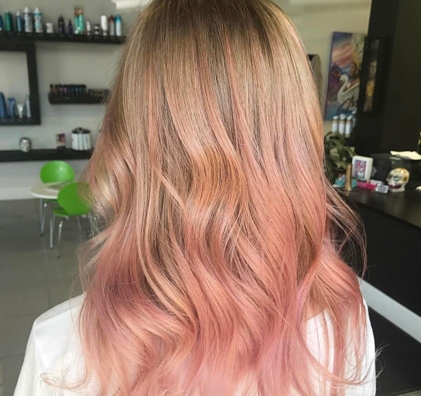 pink champagne balyage hair on woman at a salon