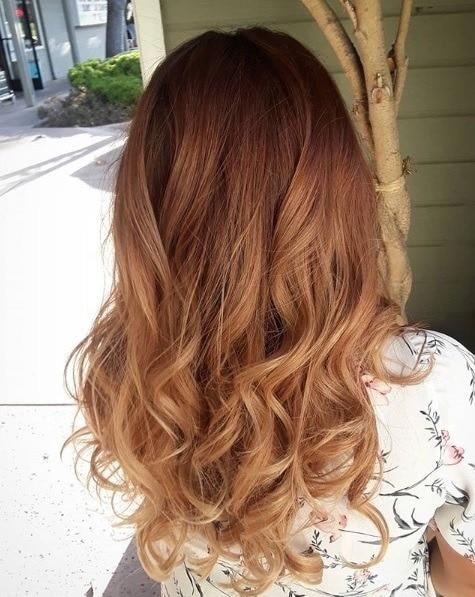 Caramel highlights: Dark red to caramel ombre shoulder-length curly hair