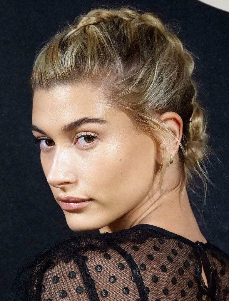 side view of Hailey Baldwin with bronde hair in a french braid