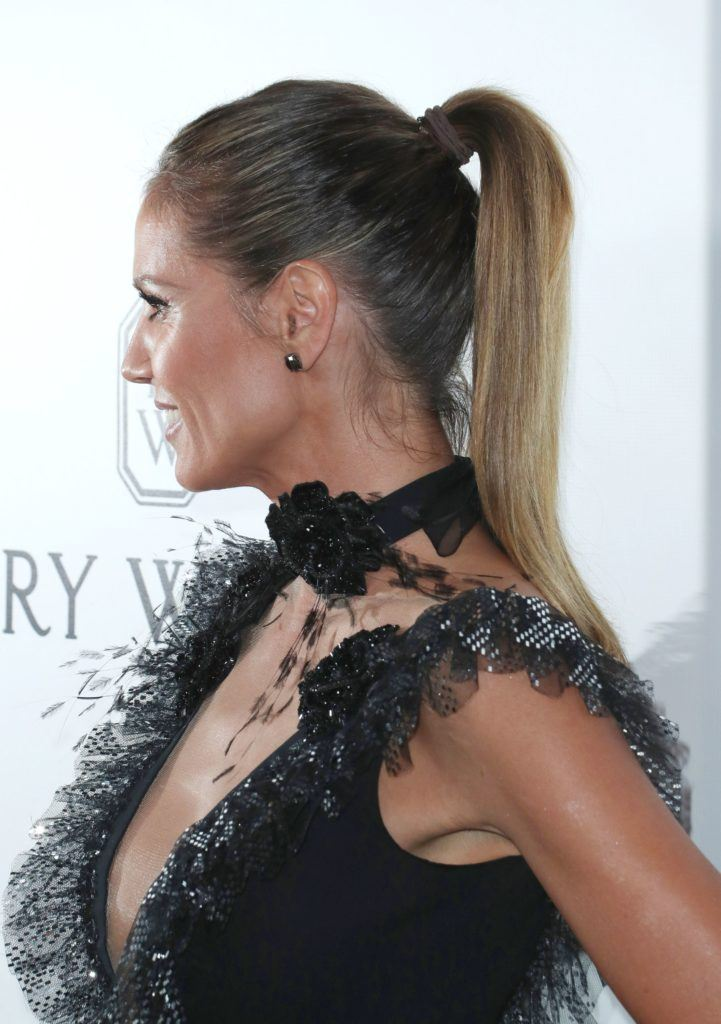 Heidi Klum with her hair in a sleek ponytail with bronde hair colouring