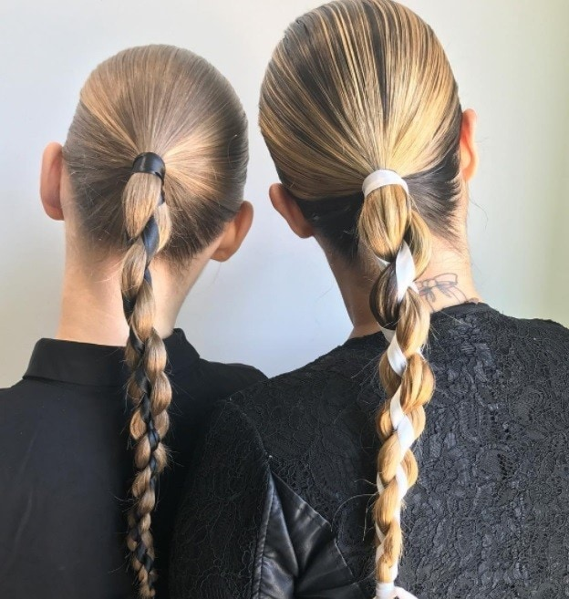 women with ribbon braided ponytail backshot