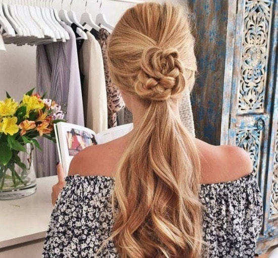 blonde woman with a flower braid ponytail