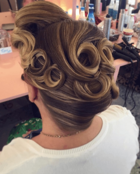 Woman with hair in updo and pin curls