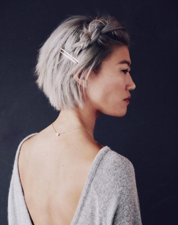 Beach hairstyle - Short bob black to grey hairstyle with side pinned braid