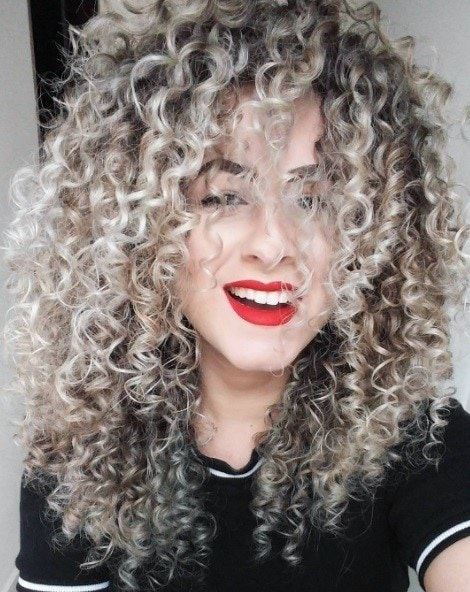 woman with silvery grey curly hair