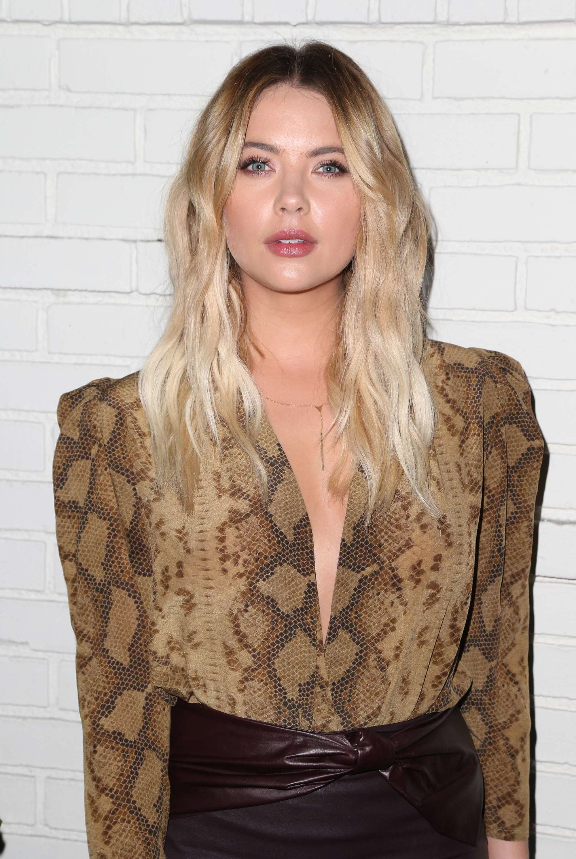 Flat iron hairstyles: Ashley Benson long blonde hair with dark roots and wavy finish.