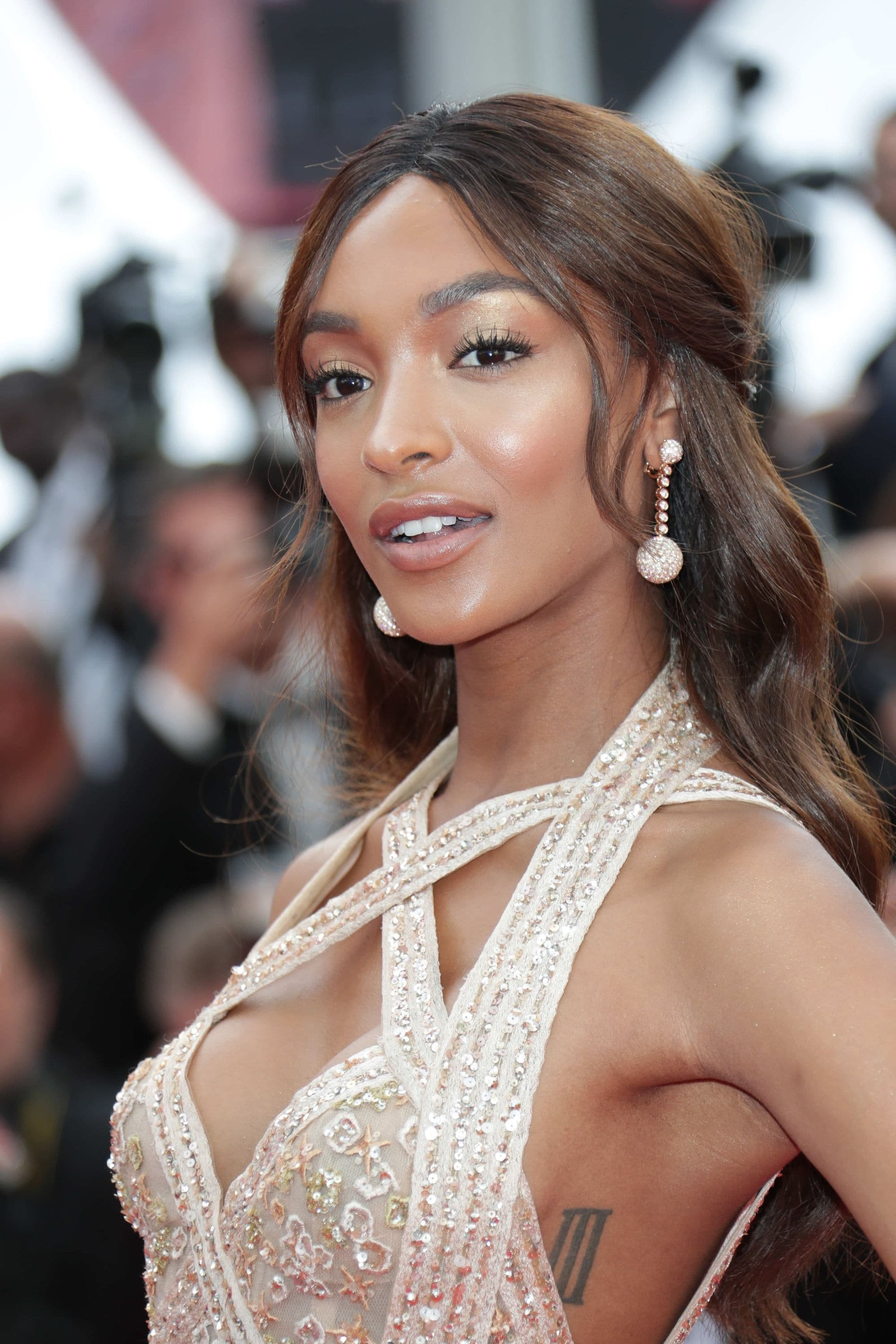prom hairstyles for black girls: Jourdan Dunn with half up half down hairstyle with waves in it