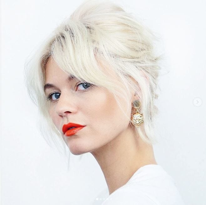 Short summer hairstyles - Light blonde hair in messy chic updo with grown out bangs