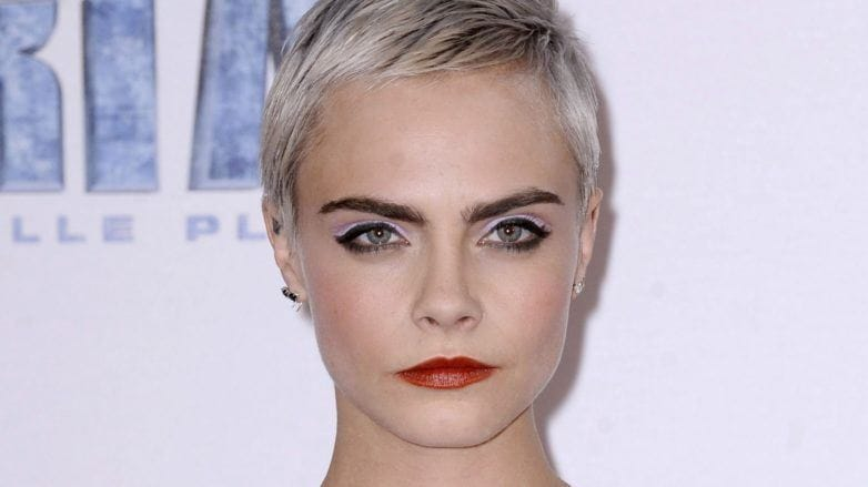 head shot of Cara Delevingne with silver pixie cut at valerian and the city of a thousand planets