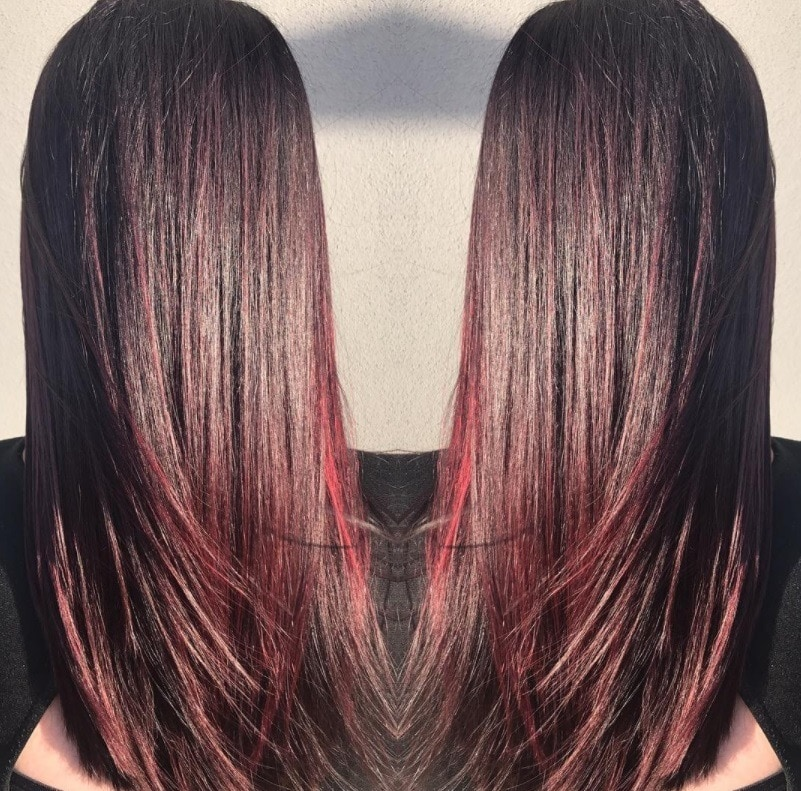 woman with long straight cherry red mahogany hair