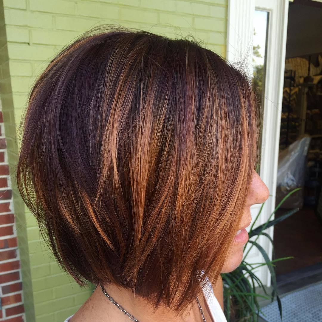 Woman with chestnut highlilghted bob cut hairstyle