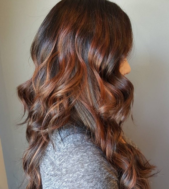 woman with chestnut brown sombre hair colour at salon
