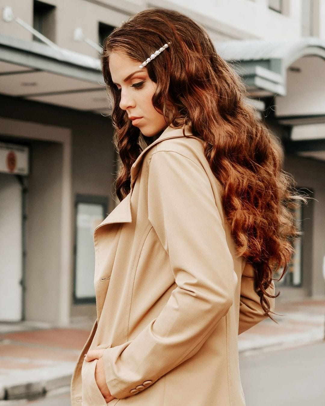 Woman with long curly chestnut brown hair