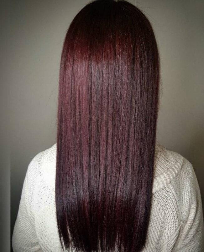 woman with long straight chocolate tinted mahogany hair