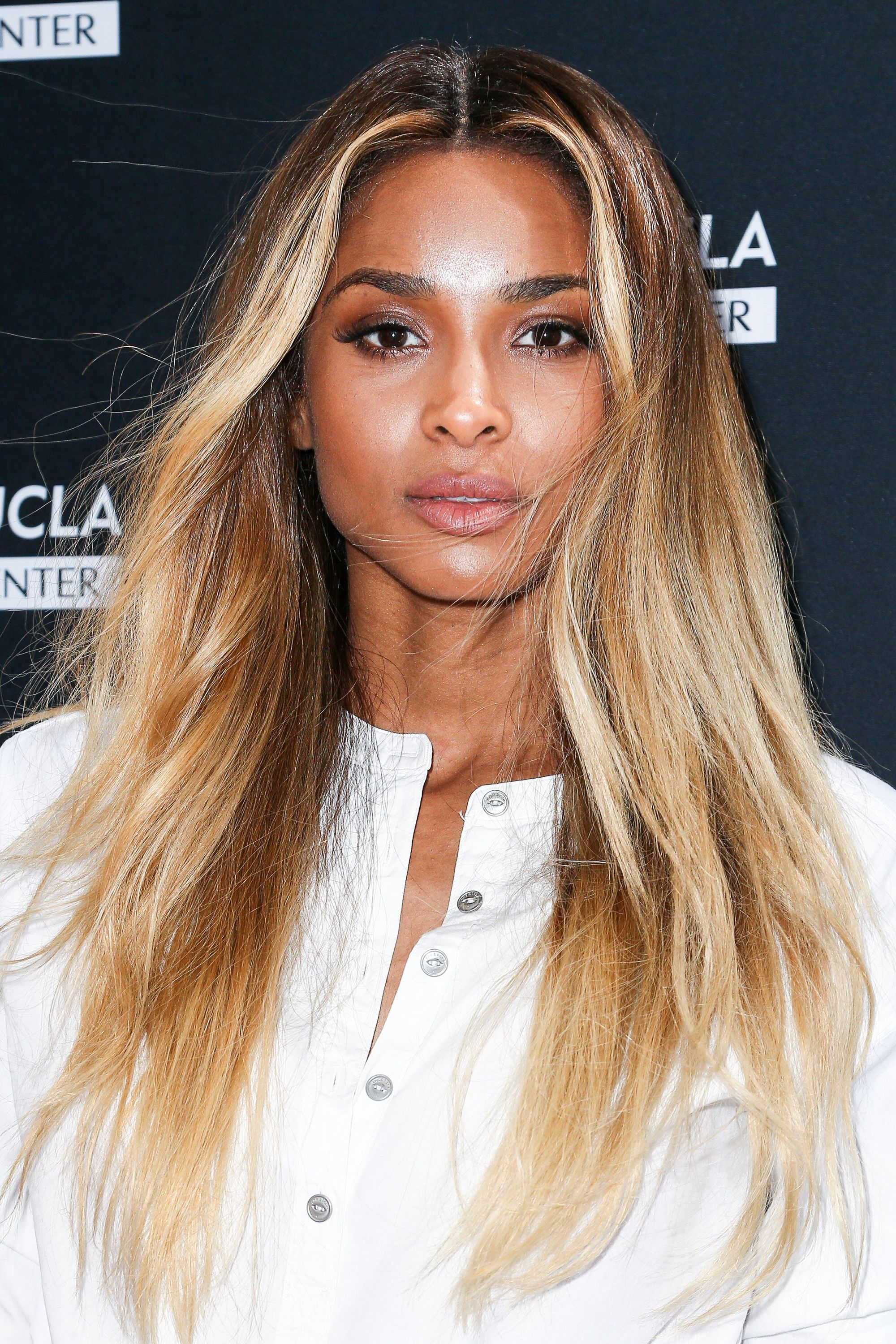 Flat iron hairstyles: Ciara with long bronde hair with light wave in the mid-section