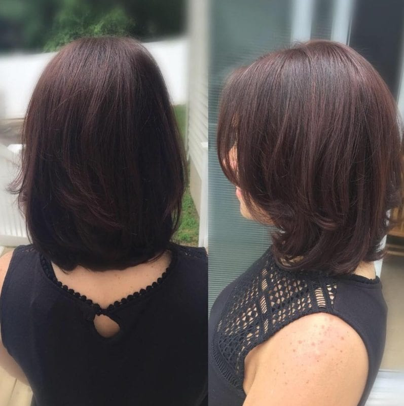 woman with shoulder length subtle mahogany brown hair