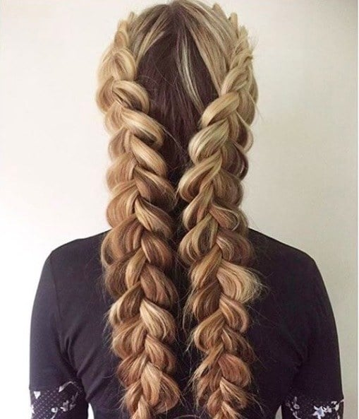 back view of a woman with long blond hair in a double dutch braid style