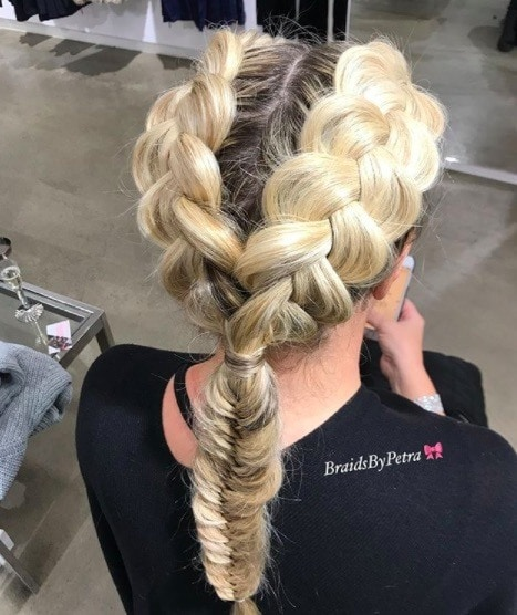 back view of a woman with double Dutch braids, blonde hair and a fishtail braid