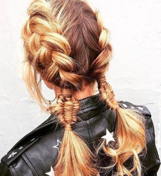 back view of a woman with blonde hair and double dutch braid style with fishtail braid