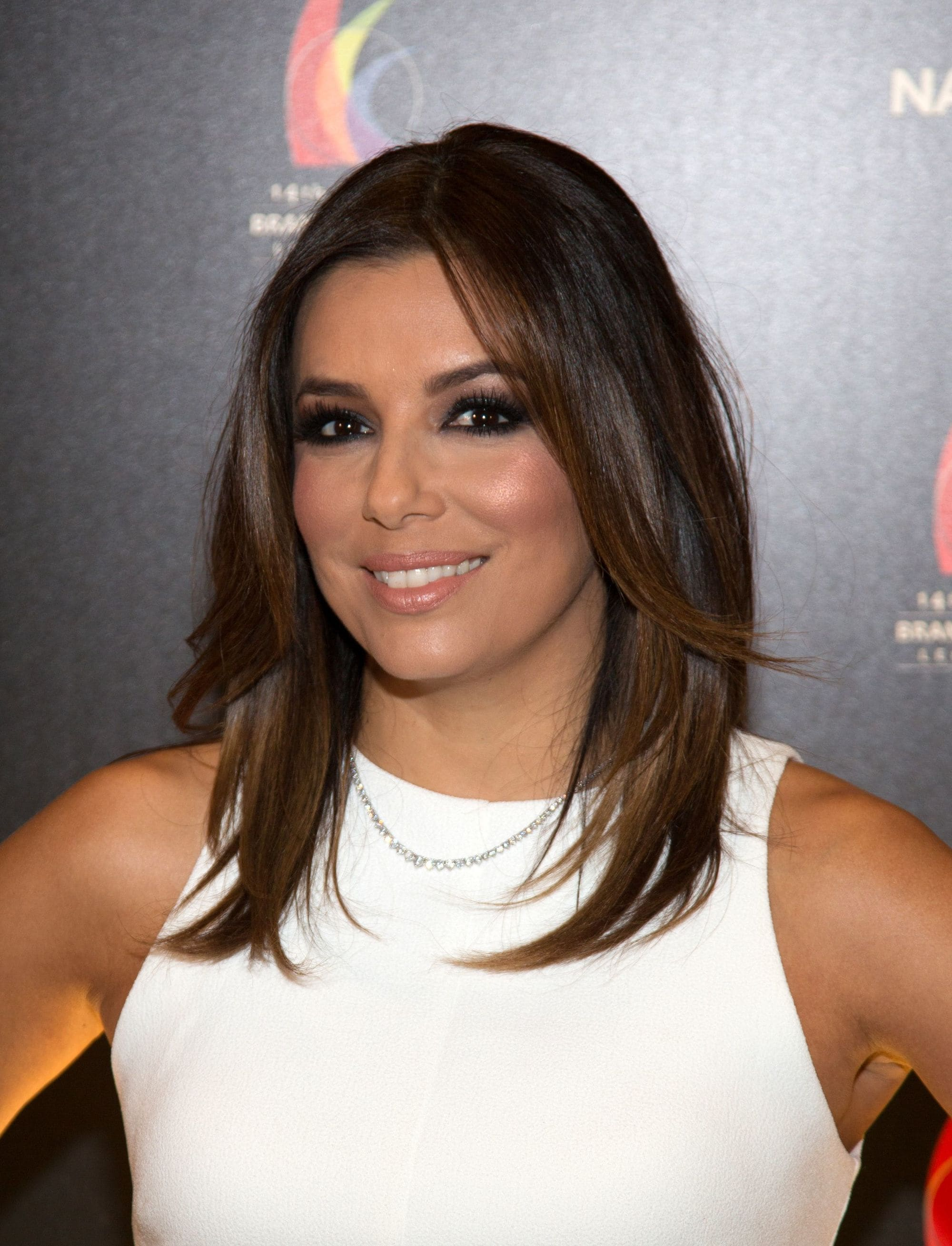 Shoulder length layered hair: actress eva longoria with shoulder length brunette hair and flicky layers