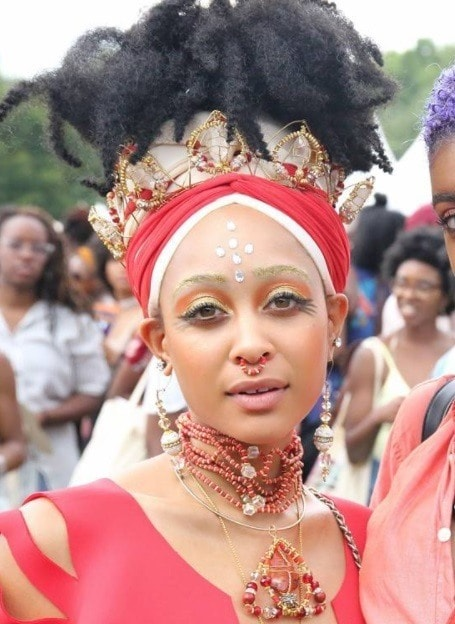 woman at curl fest 2017 with pineapple natural hairstyle wrapped up with hair accessories in red outfit