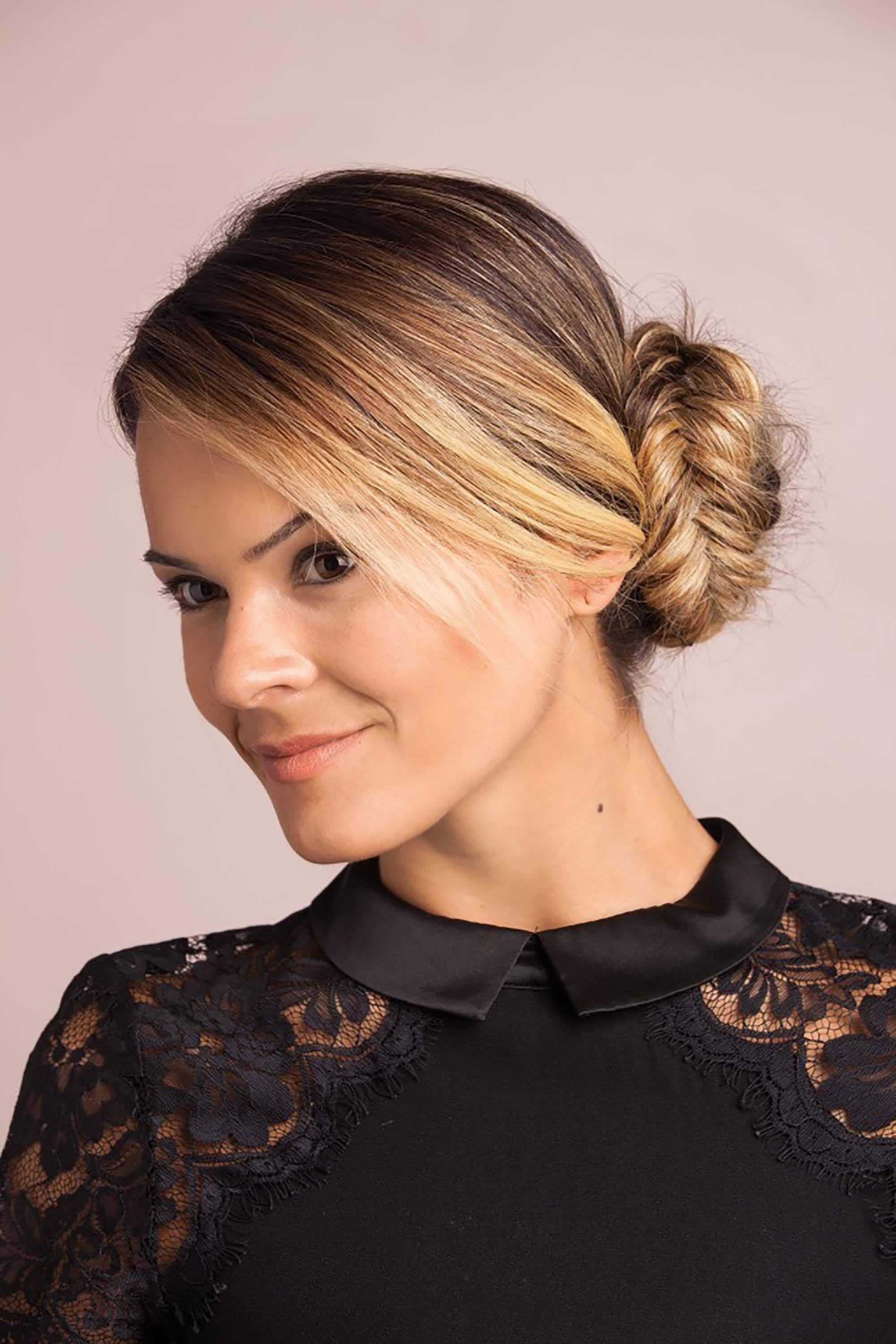 model with light brown bronde hair with smooth side fishtail braid bun