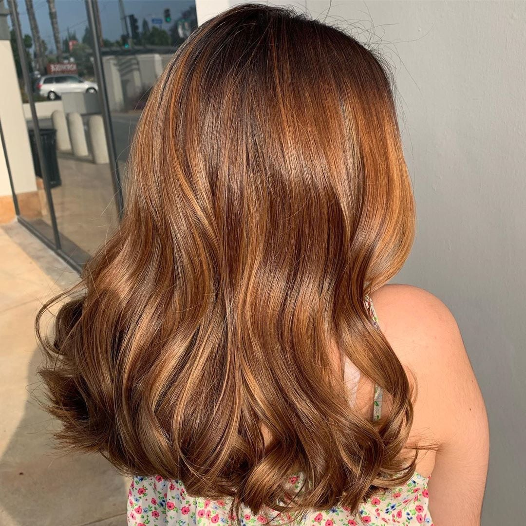 Woman with glossy long chestnut brown hair