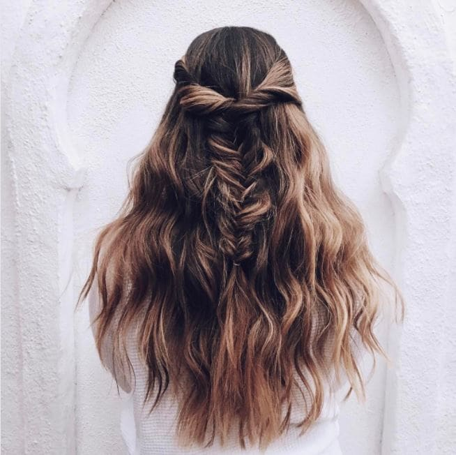 long brown wavy hair in half-up, half-down fishtail braided hairstyle