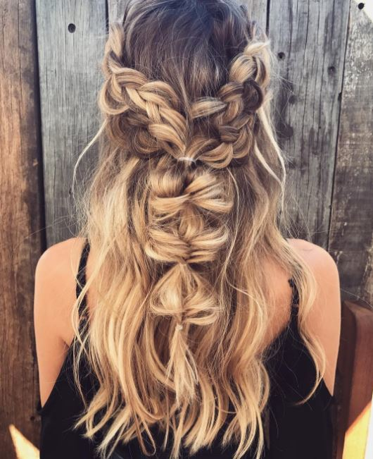 long wavy dirty blonde hair with light blonde highlights in pinned back bubble braids half-up,half-down hairstyle