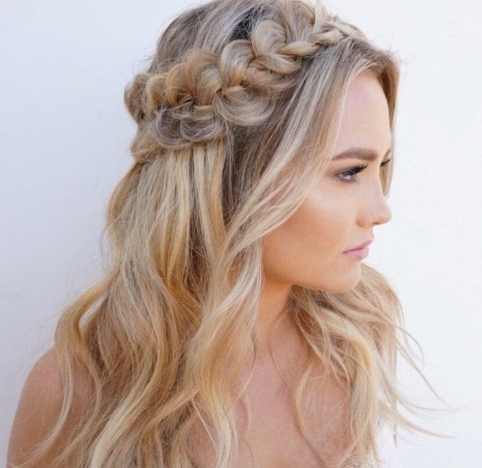 side shot of woman with half up half down wedding hair with waves in it