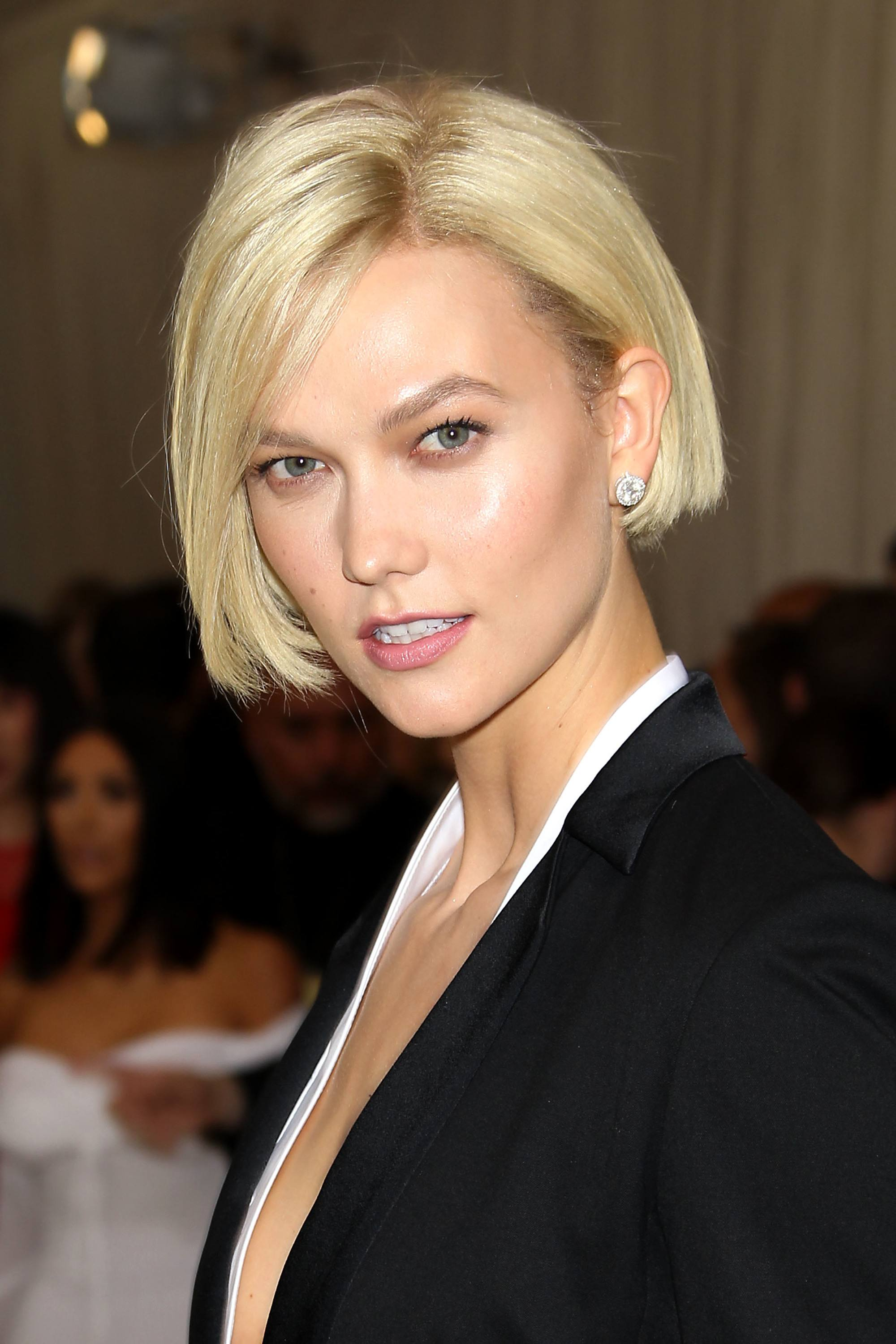 victoria's secret model karlie kloss with her blonde bob length hair tucked behind her ear