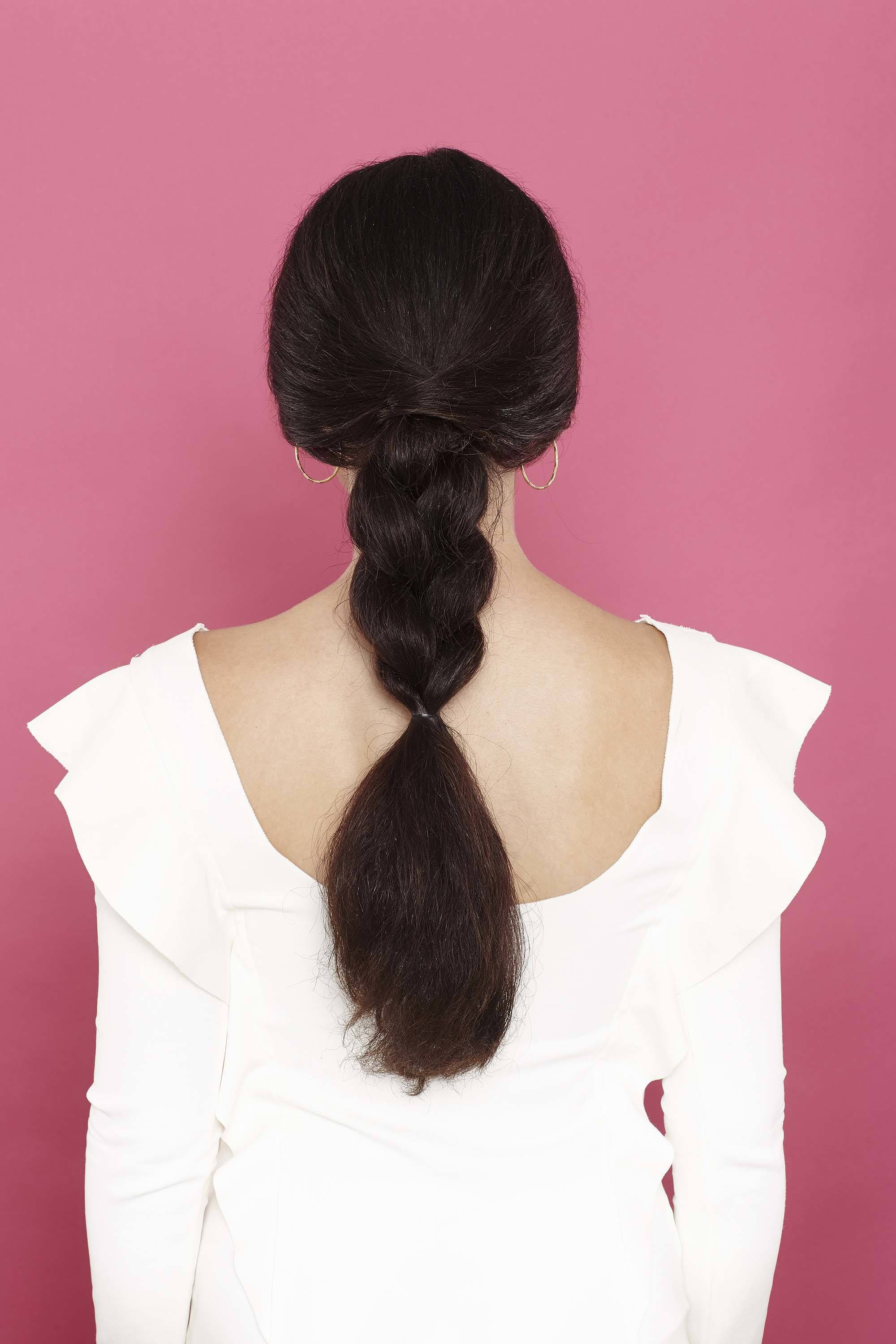 Braided wedding hair - thick long dark hair in low ponytail with braided finish