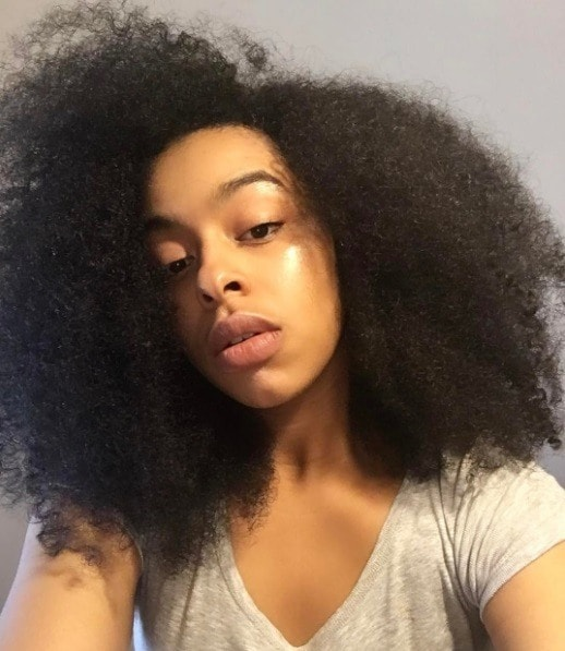 woman with long curly natural hair