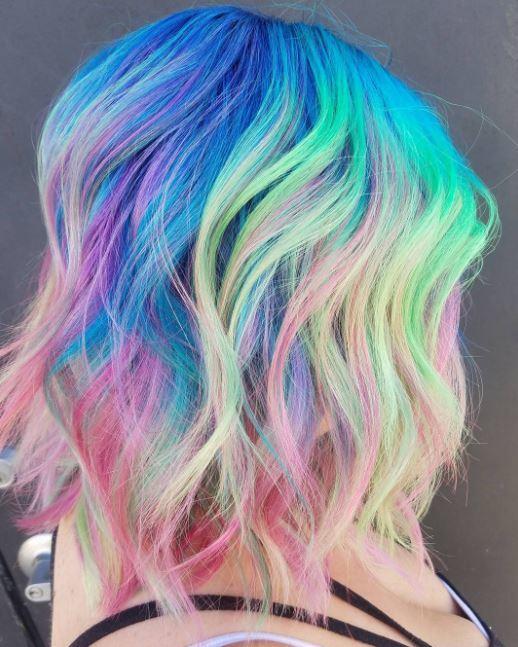 Neon rainbow hair - long bob length wavy rainbow colour hair side view