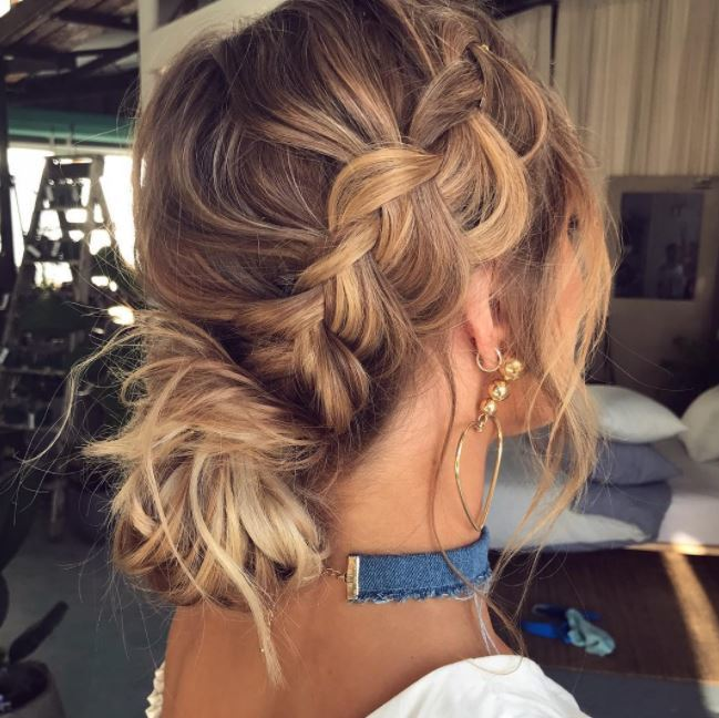 dirty blonde hair with londe sunkissed highlights and pancake side braid into low messy bun
