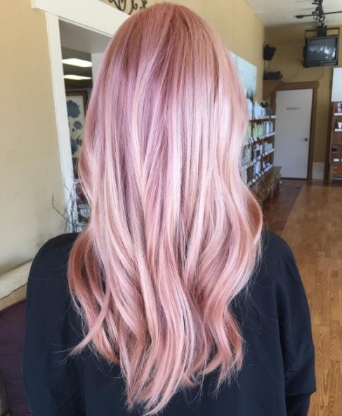 woman with long pastel pink hair