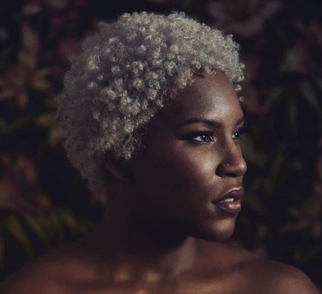 woman with short blonde afro style