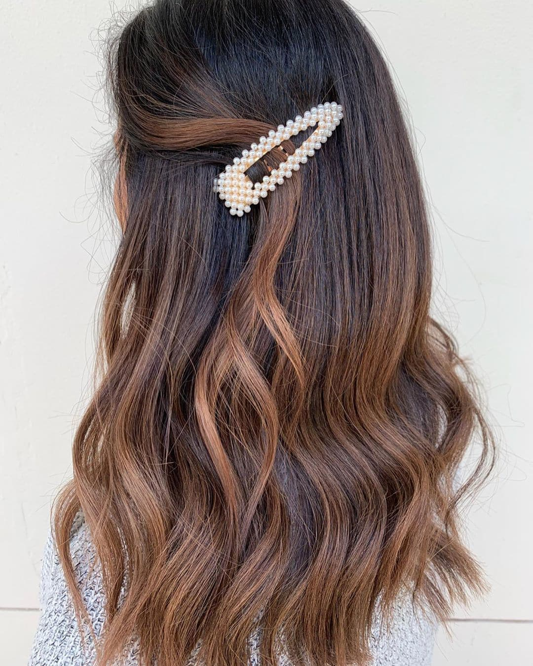 Woman with reverse chestnut brown balayage hair