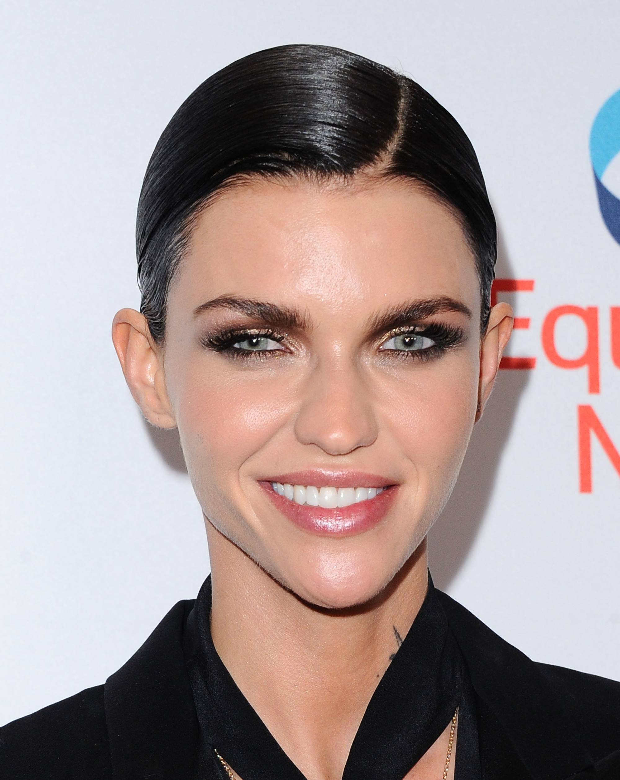 actress ruby rose with short pixie cut hair in a slick side parting