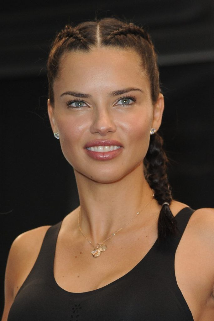 Adriana Lima with her brown hair in Double Dutch braids