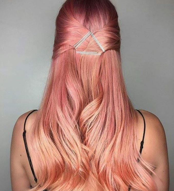 Sushi hair - long pastel peach pink hair worn in a half-up hairstyle with a geo hair accessory