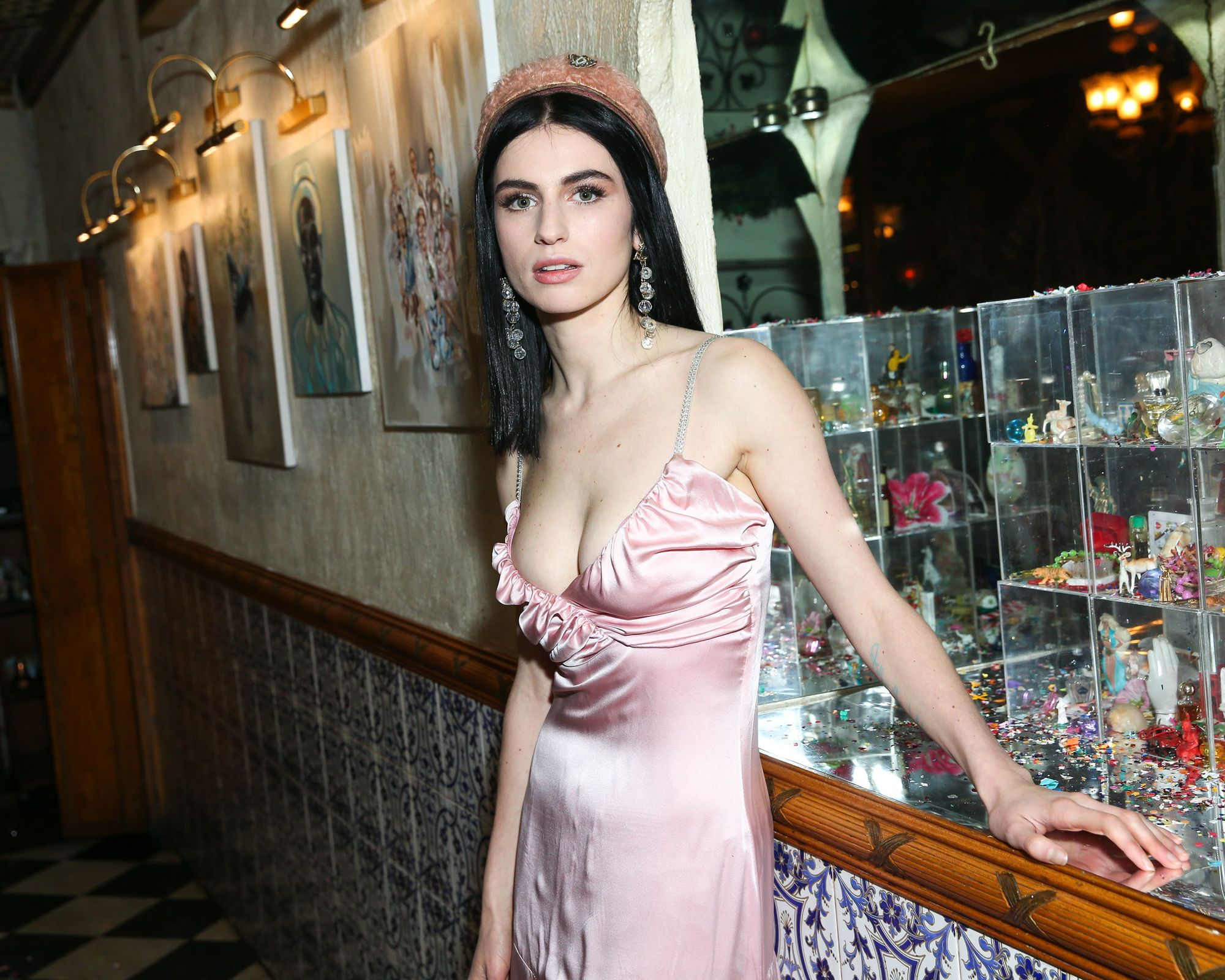 shot of tali lennox with pink satin dress and pink beret at an event
