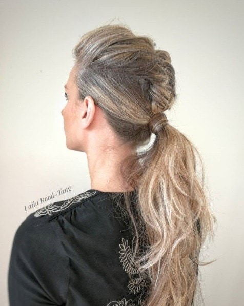 blonde woman with her hair in a unicorn braid curly ponytail wedding hairstyle