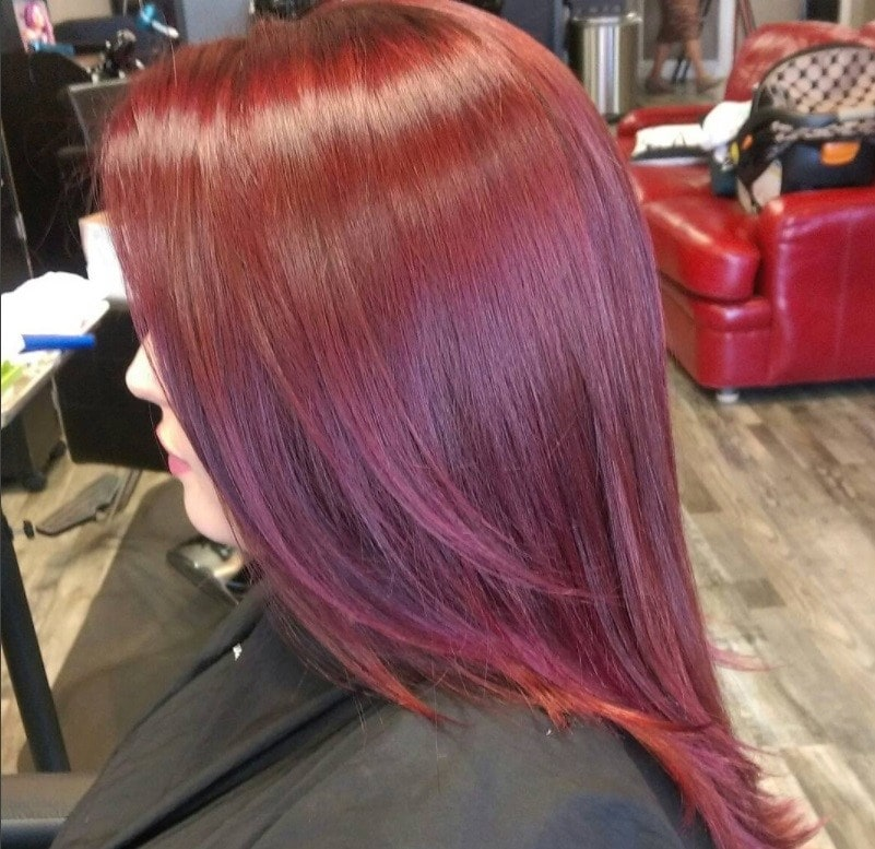 woman with sleek straightened violet tinted mahogany hair